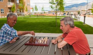 Residents Playing Chess on Patio