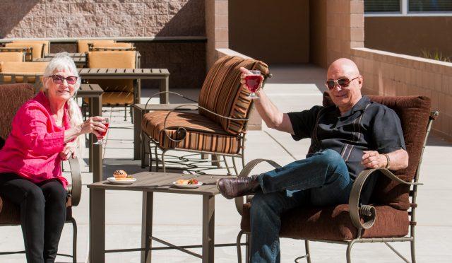 Couple on Patio Enjoying Wine